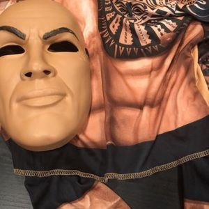 Mask and muscle shirt of The Rock